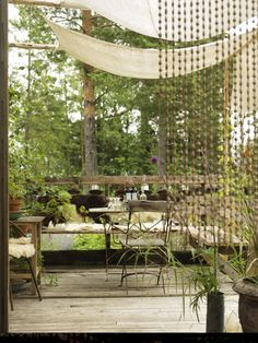 linen sails provide shade and the bead curtain makes the area bohemian