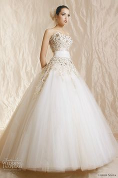 Angelique ball gown with rich embroidered French lace and Swarovski crystals embellishments.