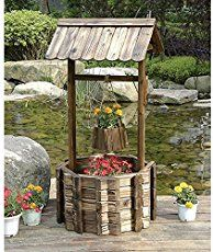 Wishing well planter made from recycled tires   The Owner-Builder Network