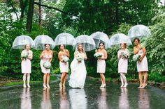 Clear bubble umbrellas are the perfect props for a rainy wedding day!