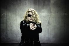 Young woman with pistol. Photo copyright Christie Goodwin, all rights reserved