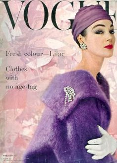 Model, Ivy Nicholson shows offna gorgeous lilac ensemble (circa 1950's) boucle coat with shawl collar, accented with a rhinestone pin