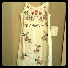 Mexican inspired dress White dress with colorful embroidered flowers. Side zipper. Hits just above the knee. Never been worn! Earthbound Trading Company Dresses