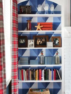 Spice up a plain bookshelf with graphic wallpaper: http://www.hgtv.com/decorating-basics/add-graphic-pop-to-a-bookcase-with-wallpaper/pictures/page-2.html?soc=pinterest