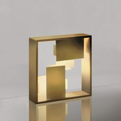 New Fato gold version by Artemide, design Giò Ponti.