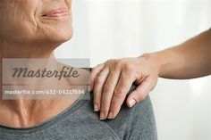 Comforting hand on senior woman's shoulder, cropped  – Image © Masterfile.com: Creative Stock Photos, Vectors and Illustrations for Web, Mobile and Print