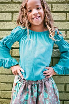 A totally turquoise knit top, a great basic under a dress or paired with a pair of big ruffles or jeans. Details in the sleeve so you don't loose the boutique look when you pair it with a dress. 100% cotton    Made with love in the USA    Awesome photography by: Della Terrah Photography http://www.dellaterraphoto.com