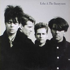 An album cover showing a black and white photograph of four men. Echo & The Bunnymen is written in the top-right corner of the cover in black text.