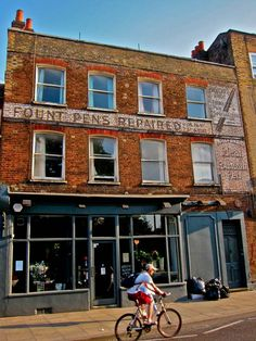 """""""Ghost Signs of Stoke Newington"""" showing an erstwhile pen repair shop."""