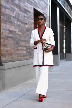 WHITE CARDIGAN BY ZARA, SIMILAR HERE | WHITE PANTS BY ZARA, SIMILAR HERE | BOOK CLUTCH | SILVER STATEMENT EARRINGS | BLACK CAT EYE SUNGLASSES | RED SHOES, SIMILAR PAIR HERE | xx, R