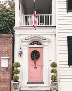 How To Work With the Color Pink - It's Not Just For Millenials! | Laurel Home - That pink door during the holidays - Love the Christmas wreath