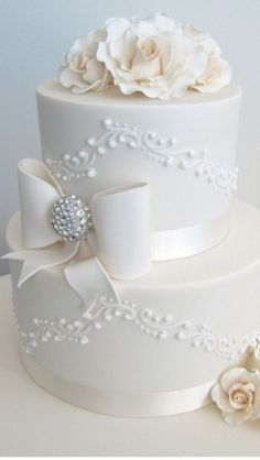 Wedding Cake with roses and piping. Love the details of the bow....