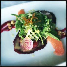 Photo of Selanne Steak Tavern - Laguna Beach, CA, United States. Scarlet beet ravioli w artisanal goat cheese, hazelnut, beet vinaigrette
