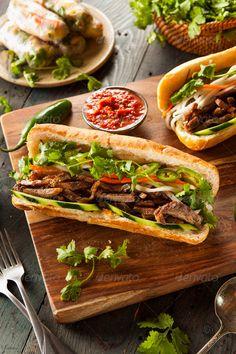 Buy Vietnamese Pork Banh Mi Sandwich by on PhotoDune. Vietnamese Pork Banh Mi Sandwich with Cilantro and Daikon Vietnamese Pork, Vietnamese Cuisine, Vietnamese Sandwich, Banh Mi Sandwich, Sandwich Ideas, Beef Sandwich, Tandoori Masala, Delicious Sandwiches, Food Design