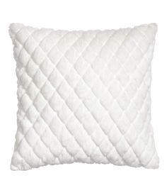 White. Cushion cover with quilted faux fur front section, solid-color cotton twill at back, and a concealed side zip.