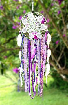 Dreamcatcher, boutique vintage style Dream catcher, beautiful hand made crochet doilies, freshwater pearls, lace, charms & natural feathers.