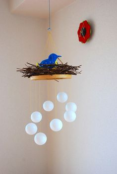 Bird's nest mobile. The blue bird of happiness.
