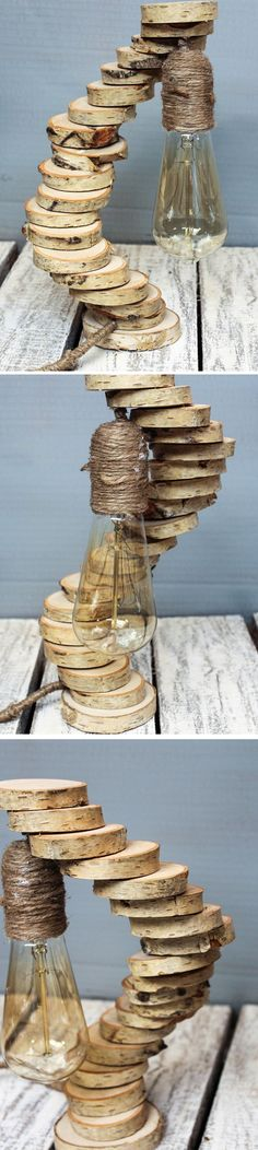 Wooden lamp made of tree slices connected to have the spiral shape. Very unique piece of home decor... Check details on the website. #wood #wooden #decor #decoration #rustic #lamp #bulb #jute #rope #diy #design #tree #slices #livingroom #edison #retro