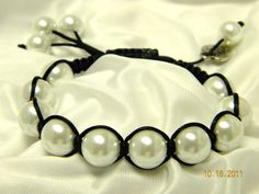 """""""Simplicity"""" is a black braided bracelet featuring glass pearls.  Price is $28"""