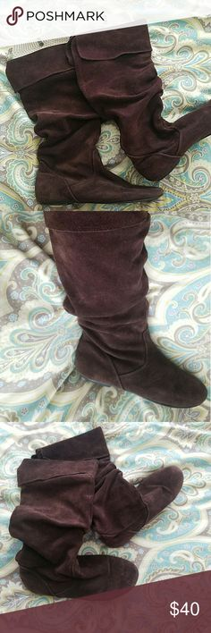 Brown suede slip on Peter Pan boots I like to call these my Peter Pan boots, because we'll that's what they remind me of ??. They easily slip on and are cute when paired with any boot socks. Bonanza Shoes
