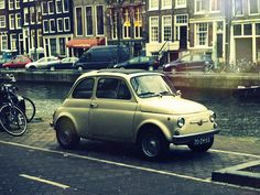 little car in the big city | Flickr - Photo Sharing!
