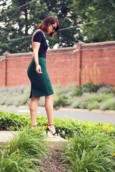 American Apparel bodysuit, green skirt, love the glasses.