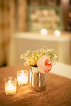 Candles, tin can and pretty flowers