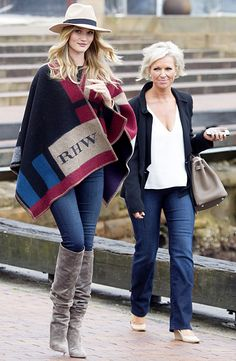 Undercover! Rosie Huntington-Whiteley wore a monogrammed shawl boarding a harbor cruise in Sydney, Australia.