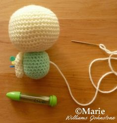 Sewing the fairy crochet doll together