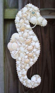 Super sweet seashell seahorse!  Now, try saying that 5 times real fast!!  LOL.  Great decor for girl's bedroom or themed birthday party.