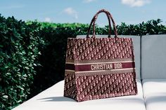 I have a confession, I want a Dior Book Tote really badly. When it first came out, I was like ya that's a fine bag but I don't need it. I suppose the power of social media is real, because I saw a lot of this bag on […] Dior Handbags, Luxury Handbags, Louis Vuitton Handbags, Purses And Handbags, Dior Boutique, Christian Dior Bags, Dior Saddle Bag, Chanel Classic Flap, Small Bags