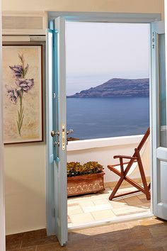 Tholos Resort Hotel Santorini - All our rooms and suites have the same wonderful view to the Aegean sea, the volcano, Skaros rock, the rest of Santorini Caldera and the world famous sunset. You just have to open your door!