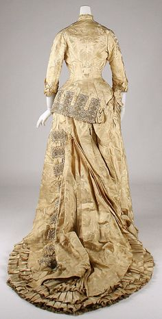 Silk damask dress with silk braid trim (back), French, ca. 1879.