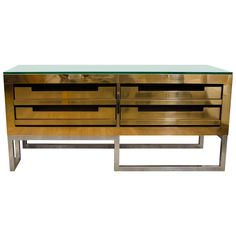 Rectangular Brass Low Console with Four Storage Drawers | From a unique collection of antique and modern console tables at http://www.1stdibs.com/furniture/tables/console-tables/