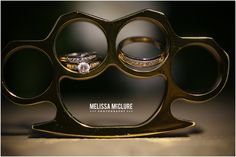Yeeow! Brass Knuckles at a wedding.  We <3 this creative photo by the oh so awesome and FABulous photographer Melissa McClure || Melissa McClure Photography ヅ