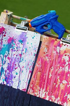 DIY Summer Water (paint) Gun. This is a great outdoor activity to keep the kids busy this summer. Fill squirt guns with watered down paint to create fun and one of a kind art work!