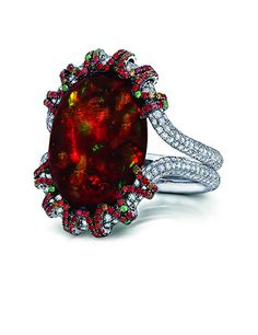 Happy 4th!  OVAL RED MEXICAN FIRE OPAL RING Cabochon fire opal, 13.18 carats; surrounded by 354 diamonds, 14 green tsavorite garnets and 179 orange-red sapphires. Micro-set diamond double band in 18K white gold setting