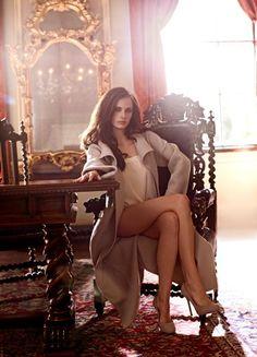 Eva Green crossed legs in a long overcoat and high heels