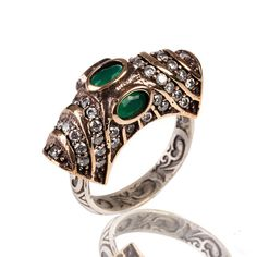 The Zerbap Hilal Ring with Zircon Emerald Stones by Rosestyle, $30.00