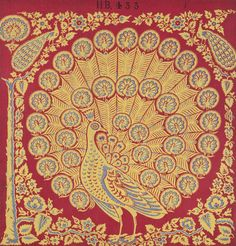 Textile sample of Turkey red dyed and printed cotton with a large hand block printed yellow and blue peacock on a red ground, with smaller peacocks making up the tail feathers. Surrounded by a floral and foliate border including a tree trunk at the left hand edge. Part of the Turkey Red Collection,  totalling c. 40,000 items: Scottish, Dunbartonshire, c. mid 19th century - c. late 19th century