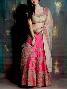A Rose Pink Lehenga Drenched In Luxurious All Over Zardosi Work In Rose Garden Motifs. The Outfit Has A Gold Dust Choli In Jaal Embroidery With Stone And Zardosi Work Adorning The Stylish Back. The Dupatta Has A Delicate Border With Rose Embroidery And Gold Dust Zardosi Work. #rose #pink #lehenga