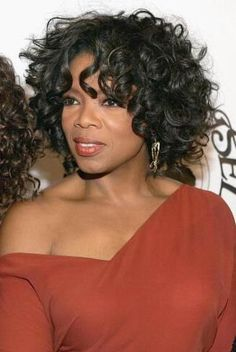 Oprah Winfrey- I used to wear this style, but became tired of roller setting every night.