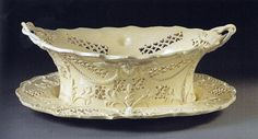 The Leeds Pottery started by a consortium of investors in `770, immediately produced creamware of excellent quality. Although they were influenced considerably by contemporary Staffordshire creamwares, the Yorkshire potteries achieved a distinctive style of their own, notably with intricate pierced decoration and delicate twisted handles.