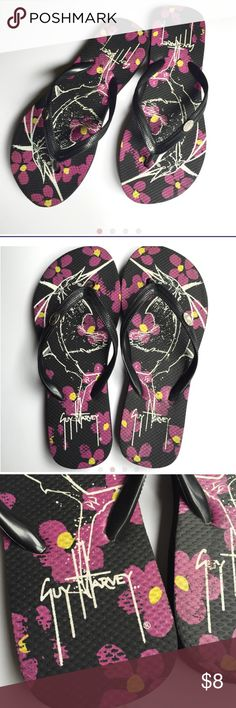 Guy Harvey flip flops Very cute flip flops with swordfish and flower detail. Made super sturdy. Worn once and some of the flowers are starting to rub off. Can see in pictures. Still in great shape and tons of wear left. These fit a women's size 5/6, but they seem to fit a little small. I'd lean more towards the 5 Shoes Sandals