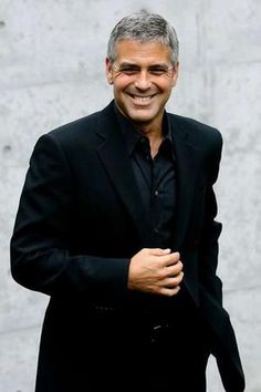 George Clooney - men always look great in all black for the holidays or any other time of the year.