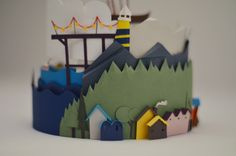 Cut paper diorama - houses & mountain