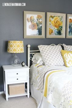 Yellows & Grays : love the framed rose pictures above the bed...and the lovely quilt