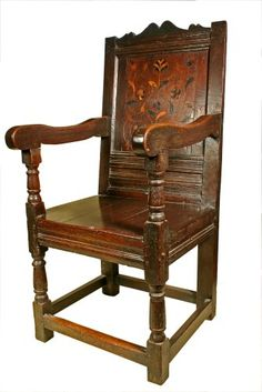 Mid 17th century Oak Wainscot Chair with parquetry inlaid panel back, baluster turned front legs and arm supports. The seat not original.