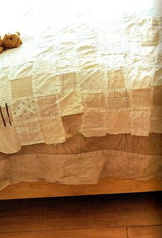 bed cover made w/vintage hankies
