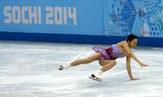 Mao Asada of Japan falls during the women's Short Programme of the Figure Skating team event at Iceberg Skating Palace during the Sochi 2014 Olympic Games, Sochi, Russia, 08 February 2014. EPA/BARBARA WALTON (1706×1024)